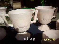 Great collection of Pink Milk Glass with Punch bowl with 31 cups Feather pattern